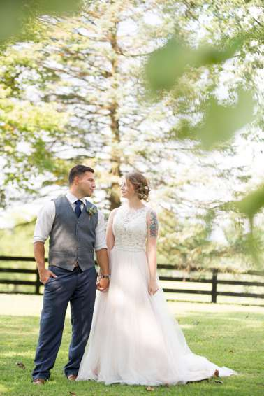 Bride and groom at Romantic raspberry and navy wedding