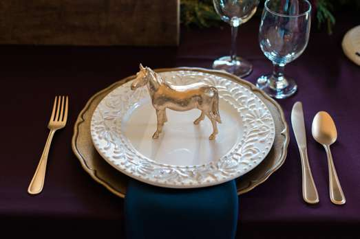 Kentucky inspired table setting with gold horse