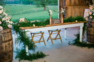 Farmhouse table as sweetheart table at barn wedding reception
