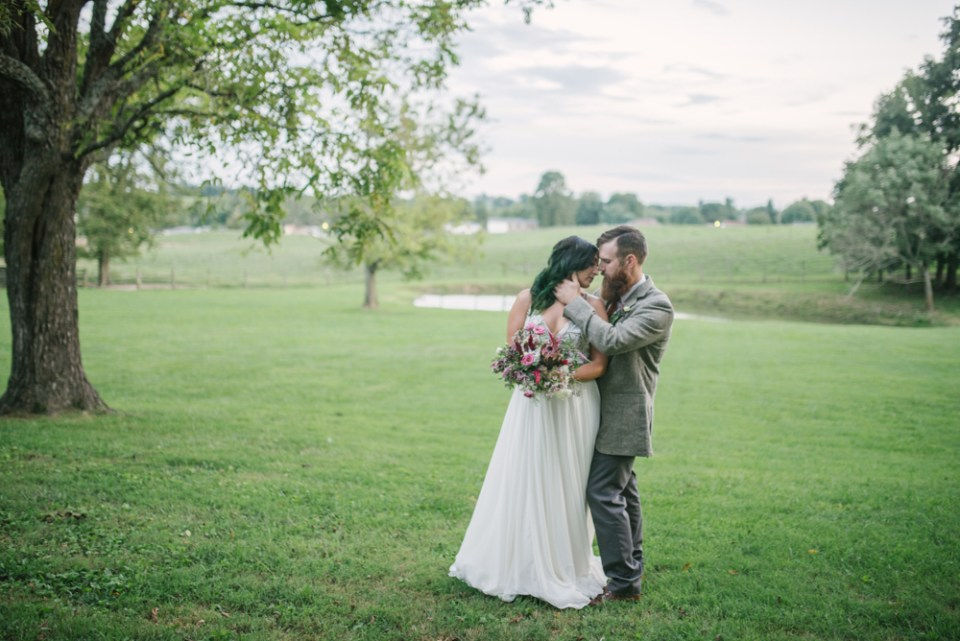 Vintage funky boho couple at summer wedding in Kentucky