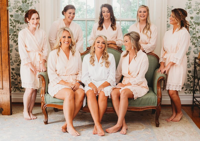 Bridal Party in blush robes for country glam wedding