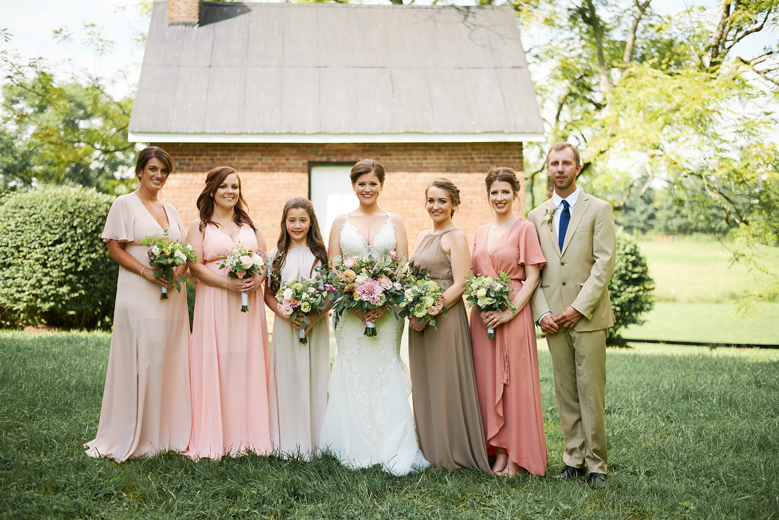 Southern glam bridal party is mismatched dresses