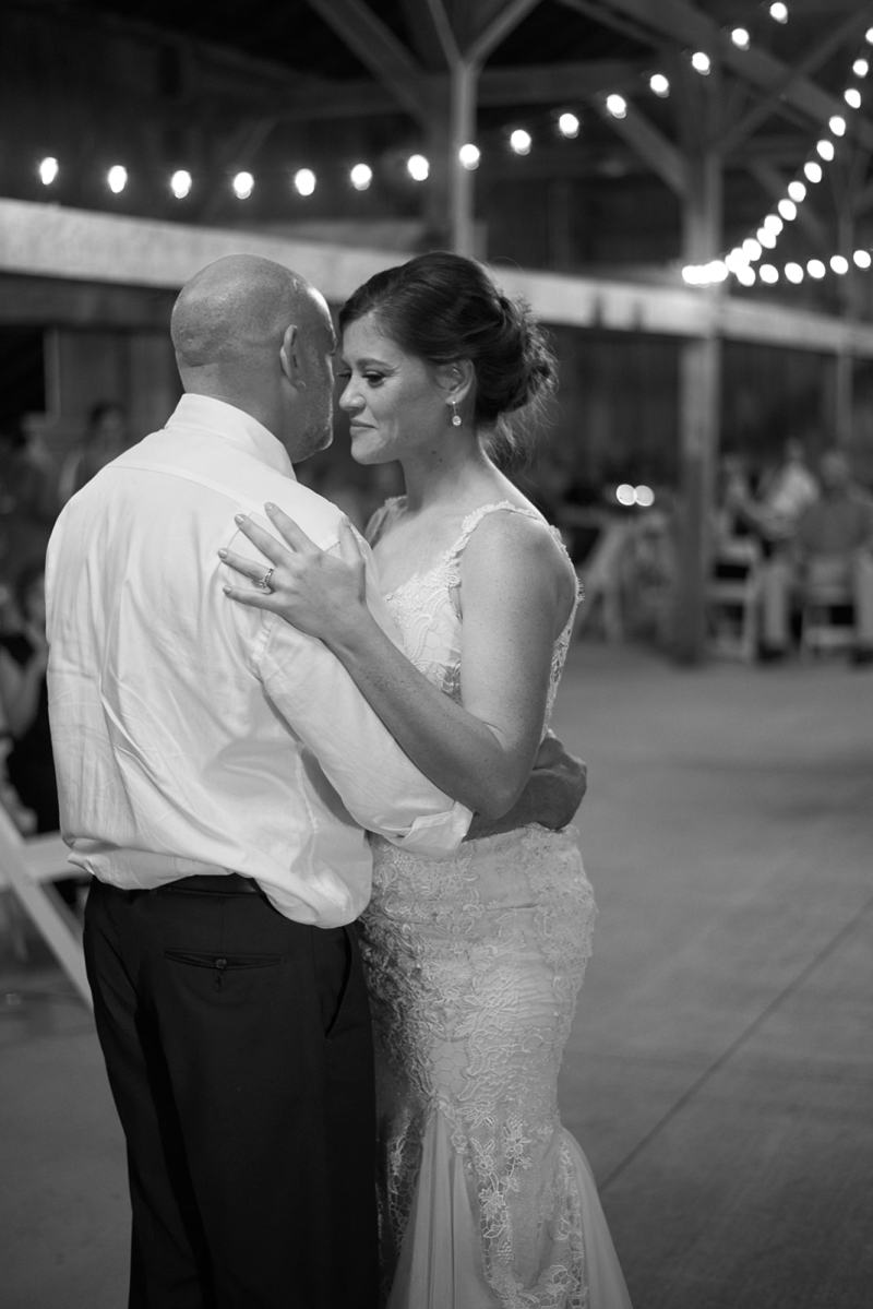 First dance of bride & groom at barn wedding reception