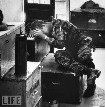 """ Inconsolable"" Larry Burrows' photograph of 21-year-old helicopter crew chief James Farley sobbing, alone, after a disastrous March 1965 mission. Marine Lance Corporal James C. Farley crying in office over death of fellow soldiers during Vietnam War,"
