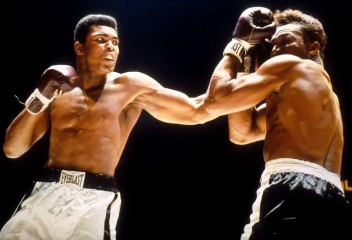 Muhammad Ali throws lead hook