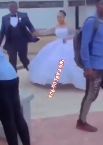 University of Abuja student makes grand entrance into exam hall in wedding dress (Video)