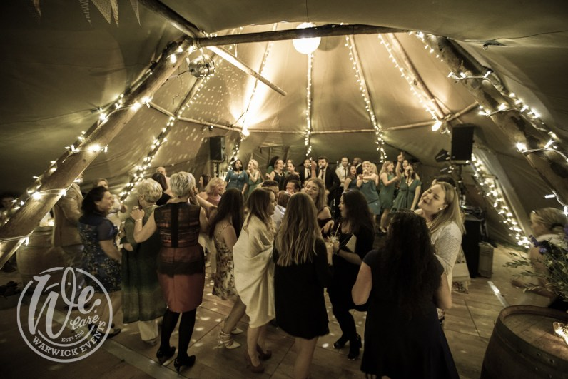 Guests Dancing in Tipi at Birthday Party