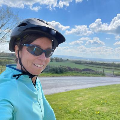 Biking tour guide, blue skies, green countryside