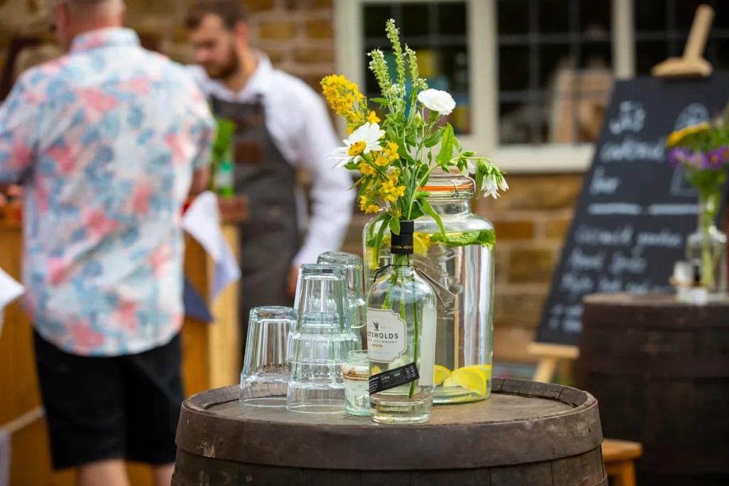 Water, glasses and Gin bottle as a vase for rustic-chic party