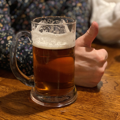 Thumbs up next to tankard of beer