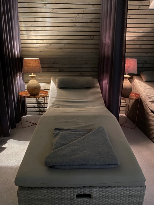 Luxurious massage bed in wellness retreat