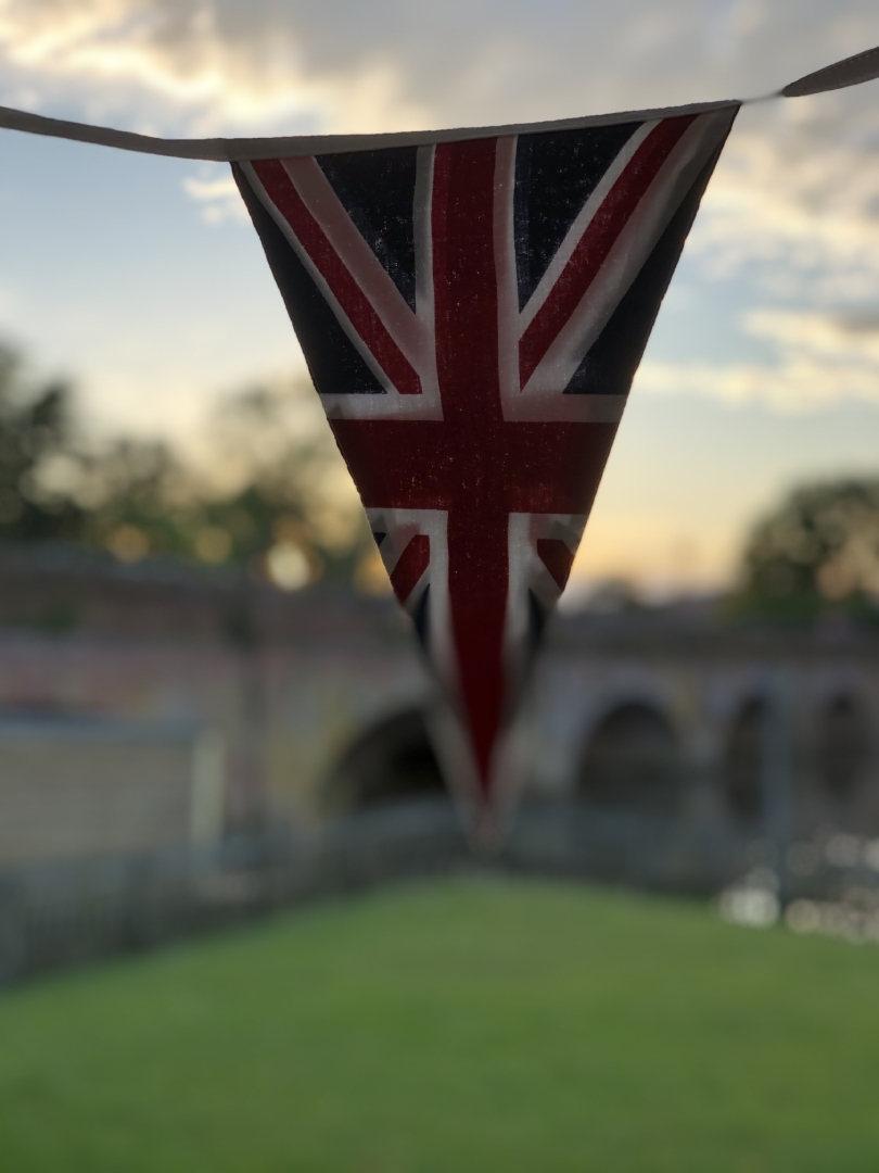 Best of British Union Jack bunting with river and bridge view