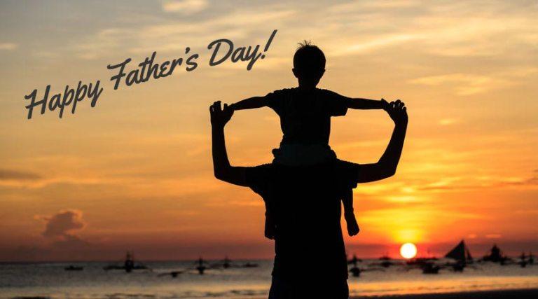 kid on fathers shoulder