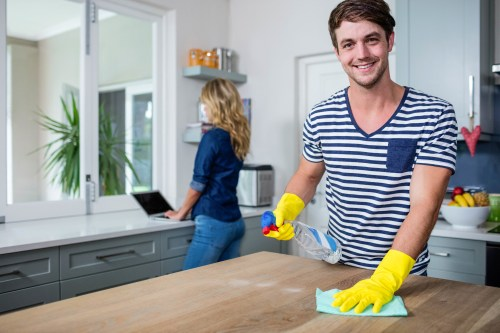 Cute couple cleaning up the kitchen