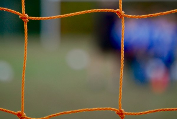 Image of soccer net with blurred background