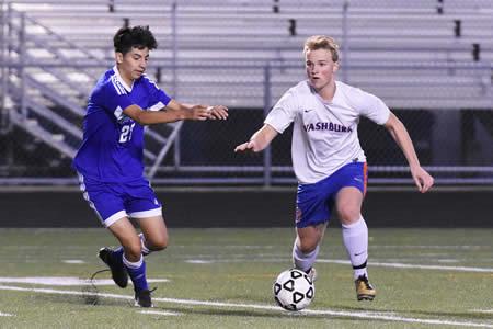 Washburn against Hopkins, varsity soccer player Andy Pulkrabek