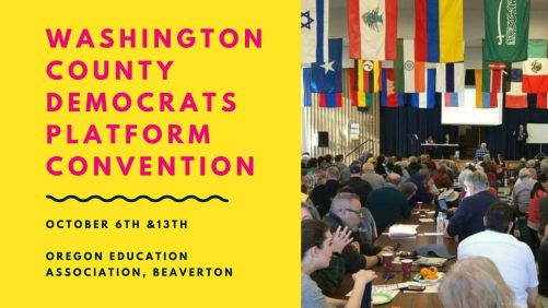 text with a photo of a local washington county democrat convention. Large group sitting facing a stage.