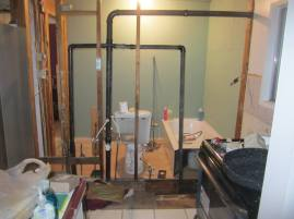 TODAY: Kitchen removed, wall being rebuilt.