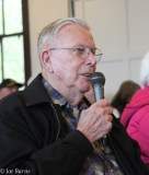 man seated with microphone