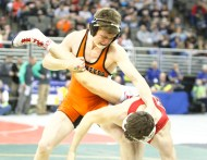 Fort Calhoun senior Lonnie Albertson wins his two opening day matches and places third.