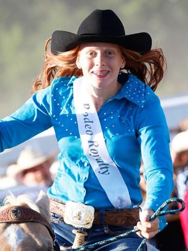Rodeo Queen contestant Lauren Schwerhelm rides in Friday night opening ceremony.