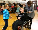 Third grade students doe the chicken dance