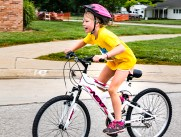 Reata Malmberg rides her bike past South school during the bike riding portion of the triathlon.Blair Kids Tri