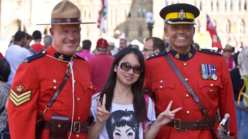 Royal Canadian Mounted Police celebrating Canada Day.