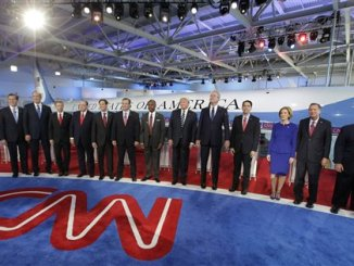 Republican presidential candidates, from left, former Pennsylvania Sen. Rick Santorum, former New York Gov. George Pataki, Sen. Rand Paul, R-Ky., former Arkansas Gov. Mike Huckabee, Sen. Marco Rubio, R-Fla., Sen. Ted Cruz, R-Texas, retired neurosurgeon Ben Carson, businessman Donald Trump, former Florida Gov. Jeb Bush, Wisconsin Gov. Scott Walker, businesswoman Carly Fiorina, Ohio Gov. John Kasich, and New Jersey Gov. Chris Christie take the stage during the CNN Republican presidential debate at the Ronald Reagan Presidential Library and Museum on Wednesday, Sept. 16, 2015, in Simi Valley, Calif. (AP Photo/Chris Carlson)