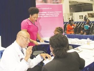 Physicians at Howard University Hospital and Medical Tactile Inc., offer free Sure Touch Breast Exams during last month's annual Congressional Black Caucus Legislative Conference at the Walter E. Washington Convention Center in Northwest. PHOTO BY SHEVRY LASSITER