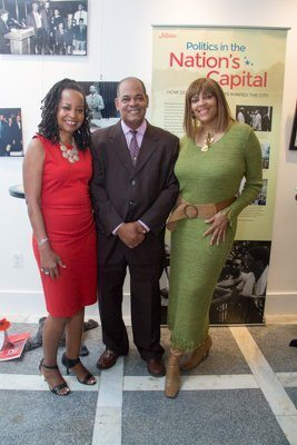 The Washington Informer Publisher, Denise Rolark Barnes (left) Director of Advertising and Marketing, Ron Burke (center) with Tracye Funn (right) at the newspaper's Fifty-50 Lens Exhibit at Gallery O/H in Northeast on Sept. 18. /Photo by Shevry Lassiter