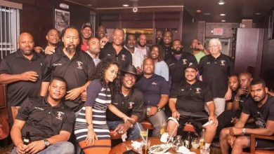 TG Cigar Lounge founder Negest Dawit poses with members of the Good Time Gang Cigar Club. (Mark Jackson/Urban News Service)