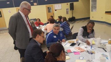 Prince George's County Public Schools CEO Kevin Maxwell (left) listens as a group discusses ways to improve transparency among school officials during a community summit at Ernest E. Just Middle School in Mitchellville on Nov. 5. /Photo by William J. Ford