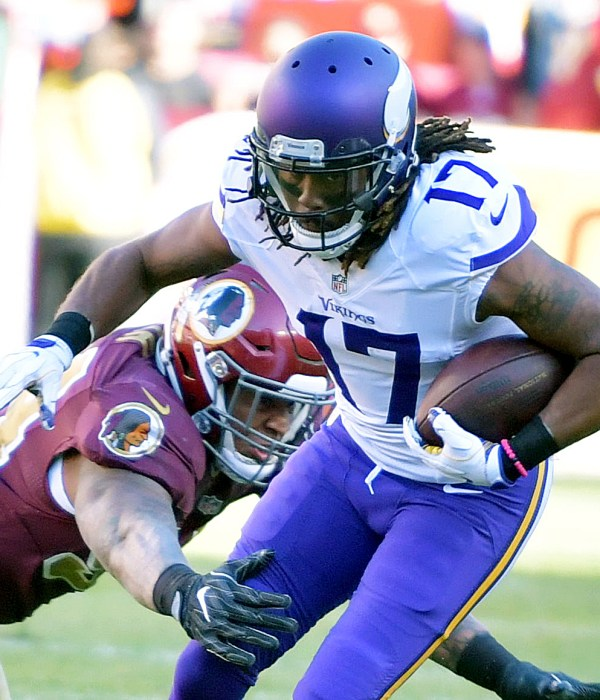 Minnesota Vikings wide receiver Jarius Wright breaks away from Washington Redskins linebacker Houston Bates during the Redskins' 26-20 win at FedEx Field in Landover, Maryland, on Sunday, Nov. 13. /Photo by John E. De Freitas