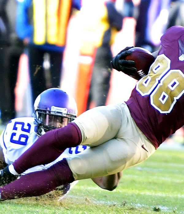 Washington Redskins wide receiver Pierre Garcon is tackled by Minnesota Vikings cornerback Xavier Rhodes during the Redskins' 26-20 win at FedEx Field in Landover, Maryland, on Sunday, Nov. 13. /Photo by John E. De Freitas
