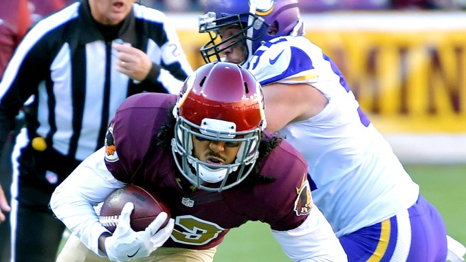 Washington Redskins wide receiver Maurice Harris slips away from Minnesota Vikings linebacker Chad Greenway during the Redskins' 26-20 win at FedEx Field in Landover, Maryland, on Sunday, Nov. 13. /Photo by John E. De Freitas