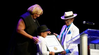 Wanda D. Lockridge, president and CEO of the William O. Lockridge Community Foundation, presents Ward 7 Council member Yvette Alexander with the 2016 award for service during the 6th annual Dancing with the Scholars competition at THEARC in Southeast on Nov. 12. /Photo by Roy Lewis