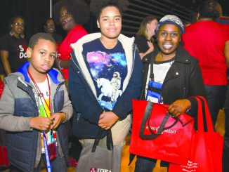 Terrance Mathews, 9, Teresa Matthews, 13 along with their mother Terie Chamberlain Matthews, 35, check out educational options during the 2015 DC EdFEST at the D.C. Armory. /WI File Photo