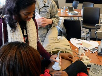 Howard University medical students demonstrate to D.C. high school students how to hear a heartbeat and check blood pressure during the Mentoring in Medicine event at the Association of American Medical Colleges in northwest D.C. on Dec. 19.