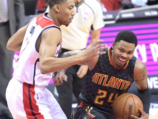 Atlanta Hawks small forward Kent Bazemore drives past Washington Wizards small forward Otto Porter Jr. during the Wizards' 95-92 win at Verizon Center in northwest D.C. on Friday, Nov. 4. /Photo by John E. De Freitas