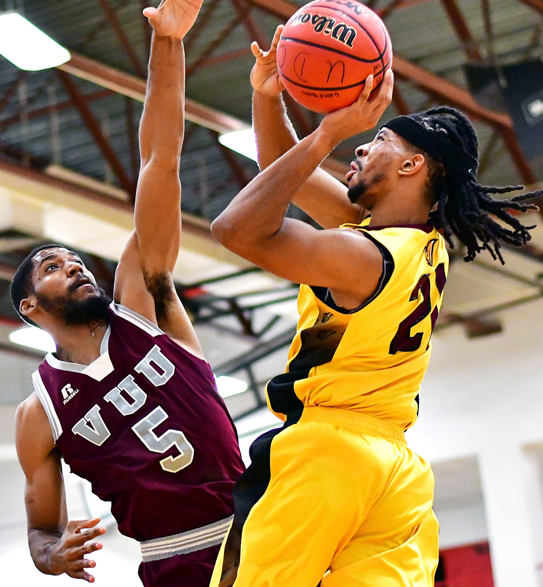 University of the District of Columbia guard Reggie Sidbury shoots over Virginia Union forward DeAndre Thomas in the first half of Virginia Union's 71-69 win at UDC Gymnasium in Northwest on Wednesday, Nov. 30. /Photo by John E. De Freitas