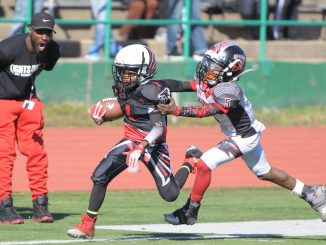 The DMV Jr. Knights (in white) and Forestville Falcons face off in the championship game for the 10U division of American Youth Football's Capital Beltway League at Spingarn High School Field in northeast D.C. on Saturday, Nov. 5. /Photo by John E. De Freitas