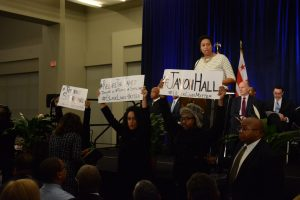 D.C. Mayor Muriel Bowser is interrupted by demonstrators pressing for additional information on two recent police shootings during a swearing-in ceremony for elected city council members at the Walter E. Washington Convention Center in northwest D.C. on Jan. 2. (Roy Lewis/The Washington Informer)
