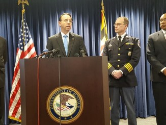 U.S. District Attorney Rod Rosenstein (at podium) speaks during a Jan. 10 press conference at the attorney's office in Greenbelt to announce the federal bribery charges against former Prince George's County Councilman and state Delegate Will Campos. (William J. Ford/The Washington Informer)