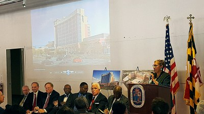 Several renderings of the Prince George's Regional Medical Center in Largo, slated to open in 2020, are placed throughout a storefront at the Boulevard at Capital Centre in Largo during an Oct. 21 event to celebrate the state's formal approval of the hospital proposal. /Photo by William J. Ford
