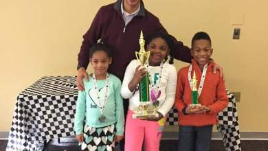 Chess competition students Noah Millhouse, Cydnee Morgan and Alexah Mitchell (Courtesy of PGCPS)