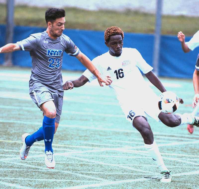 University of the District of Columbia defender Marcus Mottley clears the ball before New York Institute of Technology midfielder Jorge Sariego can get to him during the Division II matchup at Georgetown University's Cooper Field in northwest D.C. on Saturday, Oct. 1. NYIT defeated UDC 3-0. /Photo by John E. De Freitas