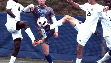 New York Institute of Technology defender Ben Wilson battles with University of the District of Columbia midfielders during a matchup at Georgetown University's Cooper Field in northwest D.C. on Saturday, Oct. 1. NYIT defeated UDC 3-0. /Photo by John E. De Freitas