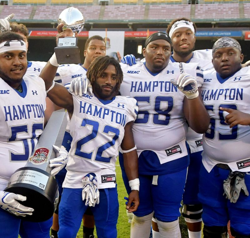 Members of the Hampton Pirates show off their trophy after a 34-7 win over the Howard Bison in the Nation's Football Classic at RFK Stadium in southeast D.C. on Saturday, Sept. 17. /Photo by John E. De Freitas
