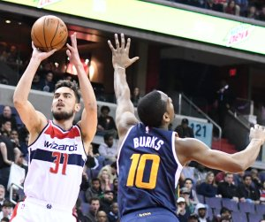 Washington Wizards guard Tomas Satoransky attempts a jump shot over Utah Jazz guard Alec Burks in the fourth quarter of Utah's 102-92 win at Verizon Center in northwest D.C. on Feb. 26. (John De Freitas/The Washington Informer)